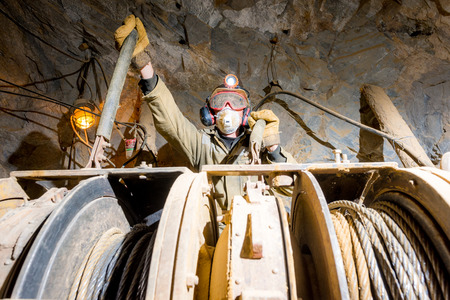 gold mine: Russia - August 2014: Miner poses for a photograph inside a gold mine. Editorial