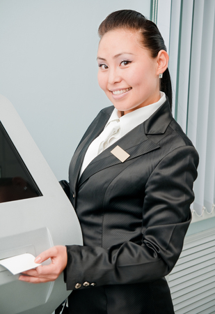 bank manager: Manager by an ATM in the bank Stock Photo