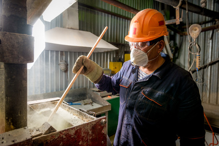 Siberia, Russia - August 13, 2014: moulting gold at a factory
