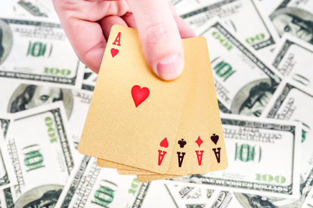 texas hold em: Gold poker cards on money background on a table