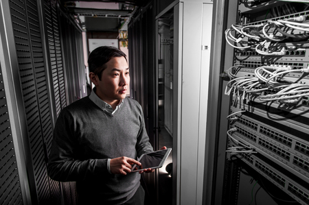 young engineer: Young engineer businessman in network server room