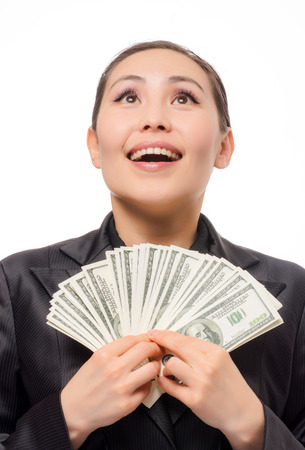 tax tips: Young asian businesswoman with money on white background