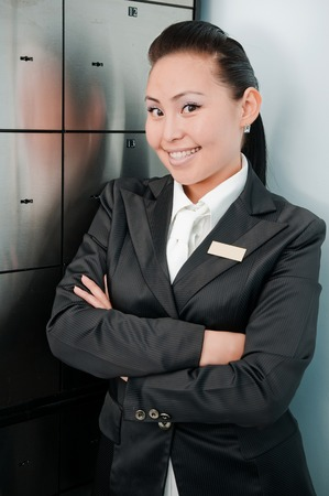 depository: Young beautiful asian bank worker at depository