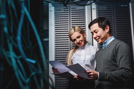 Young engineers businessmen in network server room Standard-Bild