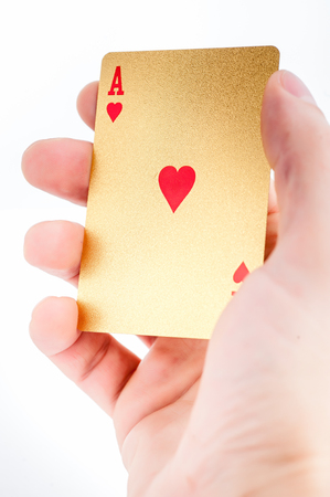 red bluff: Golden ace in a hand on white background Stock Photo