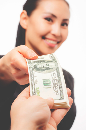 boodle: Young asian businesswoman with money on white background