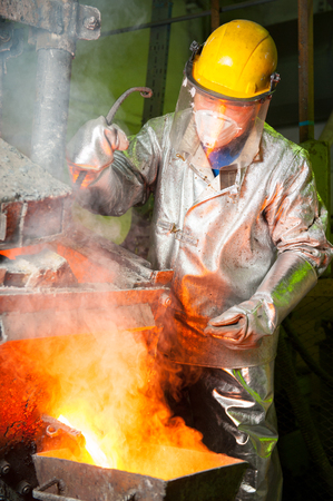 smelting plant: Siberia, Russia - August 13, 2014: molting gold at a factory Editorial