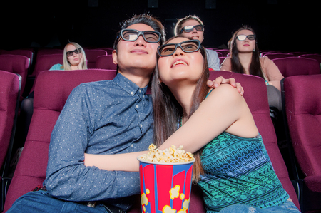 melodrama: People in the cinema wearing 3d glasses and watching movie