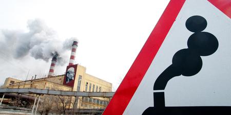 Coal powered plant and smoke stacks. Smoke sign. Stock Photo