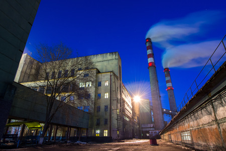 resourse: Coal powered plant and smoke stacks at night
