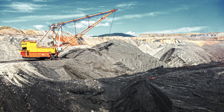 dragline: Dragline on open pit coal mine in Russia Stock Photo