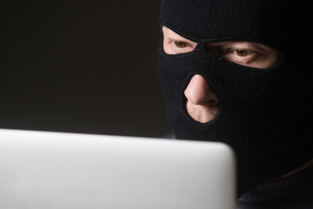 cyber terrorism: Terrorist in a mask using computer for crime