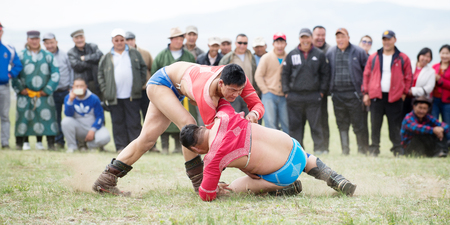 catch wrestling: Darkhan, Mongolia - May 21, 2014:  Mongolia wresting during Naadam festival. Editorial