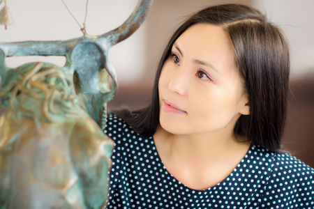 artwork: Young asian woman as a visitor in the gallery Stock Photo