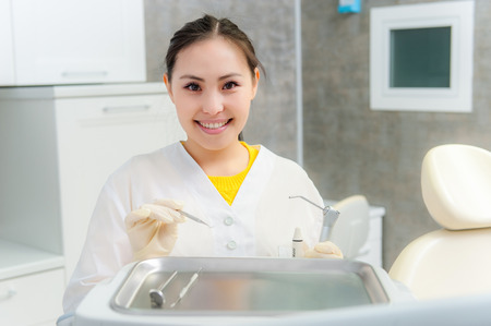 femal: Portrait of a young femal dentist in the office Stock Photo
