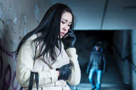 a situation alone: Asian woman asks for help over the phone