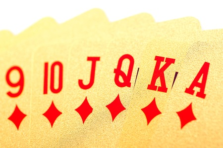 texas hold em: Golden playing poker cards on white background Stock Photo