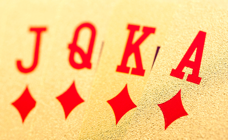 hold em: Golden playing poker cards on white background Stock Photo
