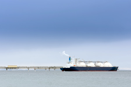 Liquefied natural gas tanker at the port Stock Photo