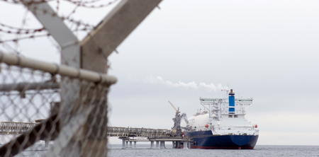 liquefied: Liquefied natural gas tanker at the port Stock Photo
