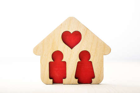 family moving house: Little wooden house with couple inside of it