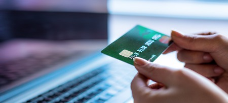 Close up of a bank card. Making online payments