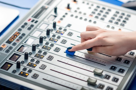 remote controls: Professional audio mixing console with faders and adjusting knobs - radio
