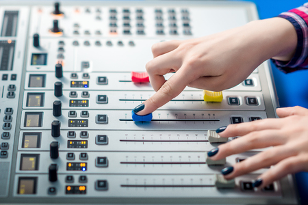 knobs: Professional audio mixing console with faders and adjusting knobs - radio