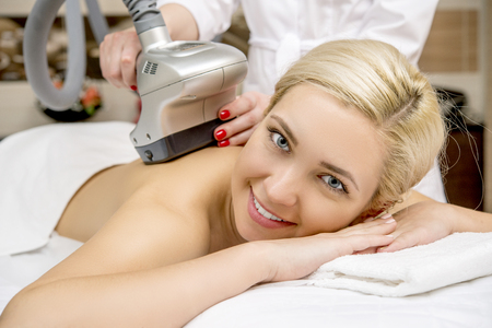 female patient getting a massage in a spa salon Stock Photo