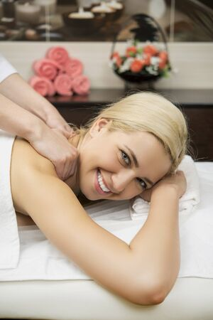 natural therapy: Female in tha spa salon taking a massage Stock Photo