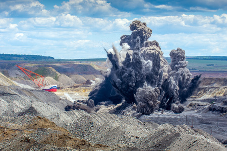 Explosive works on a coal mine open pit Imagens - 60265756