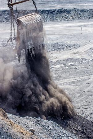 dragline: dredge ladle at open pit droping rocks