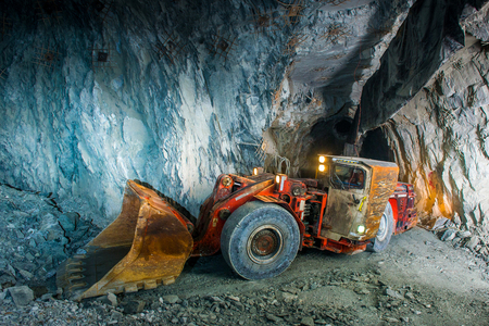 Working inside gold mine tunnel. Gold mining. 写真素材