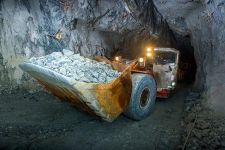 Working inside gold mine tunnel. Gold mining. Foto de archivo