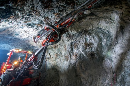 gold mining: Gold mining underground inside a tunnel. russia