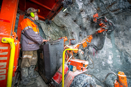 mining gold: Gold mining underground inside a tunnel. russia