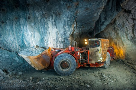 gold mining: Working inside gold mine tunnel. Gold mining. Stock Photo
