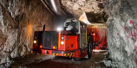 loading truck: Loading truck with golden ore underground. russia.