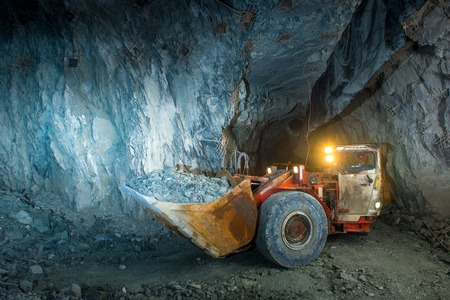 Working inside gold mine tunnel. Gold mining. Stockfoto