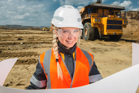 architectural survey: young beautiful female worker at an open pit Stock Photo