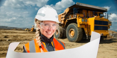 young beautiful female worker at an open pit Stock Photo