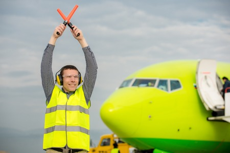 stop and go light: air traffic controller holding light signs at the airport Stock Photo