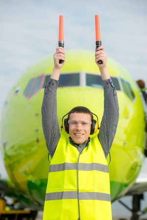 traffic controller: air traffic controller holding light signs at the airport Stock Photo