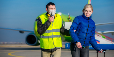 arrested: arrested woman escorted with an airport worker Stock Photo