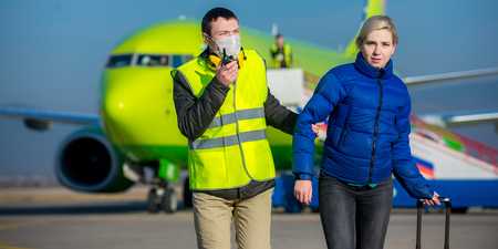 arrested woman escorted with an airport worker Stock Photo