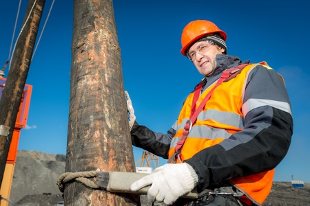 lineman: Russia - oktober, 2016: Electrician lineman repairman worker at climbing work on electric post power pole