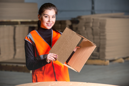 paper mill: Paper mill factory female worker with new box in her hand