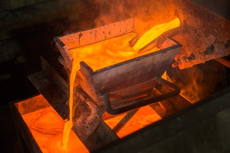 gold mining: Casting gold at a factory. Gold mining. Stock Photo