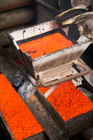 ferrous foundry: Casting gold at a factory. Gold mining. Stock Photo