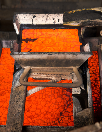 smelting plant: Casting gold at a factory. Gold mining. Stock Photo